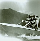 Young couple travelling the speedboat