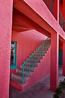 Stairway at brightly colored partment building, Truth or Consequences, New Mexico, USA