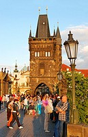 Tourists on Charles bridge in Prague  View to the Old town bridge tower