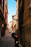 Typical narrow street of Italian town Chioggia