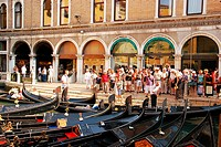 Gondolas parking in Venice  Tourists choose gondolas for traditional venetian gondola ride  Bacino Orseolo