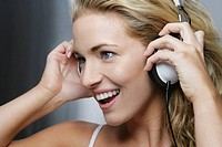 Beautiful woman listening to music with head phones