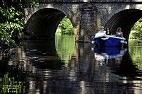 ELECTRIC BOATS ON THE MOAT AND MEDIEVAL BRIDGE, BONNEVAL, EURE_ET_LOIR 28, FRANCE