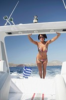 Young woman in bikini posing in a speedboat