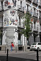 FACADE OF OF A PAINTED BUILDING ON THE CALLE CAMPOAMOR, CHUECA QUARTER, MADRID, SPAIN
