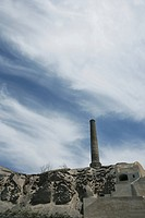 View of a tower on rocky mountain against blue sky