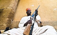 A Mossi chief holding his riffle in his village in Central Burkina Faso.