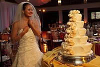 Bride by cake