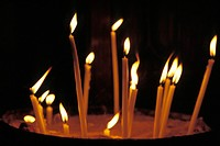 lit candles of different lengths