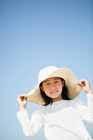 Low Angle View of Young Girl Wearing Sun Hat