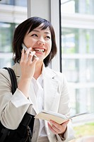 Businesswoman With Personal Organizer Talking on the Phone