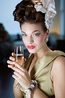 Portrait of stylish woman drinking champagne at Christmas party