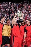 Football team winning a trophy