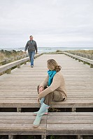 Woman and man on coastal walkway