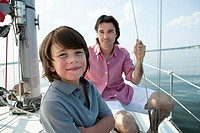 Father and son on board yacht, portrait (thumbnail)