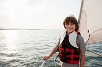 Young boy on board yacht