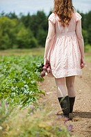 Young woman in field with beets