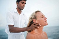 Woman having her neck massaged, South Huvadhu Atoll, Maldives