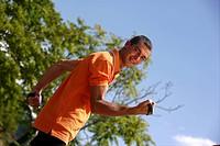 Man exercising outdoors ...