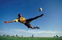 Soccer,soccer player kicking ball.                                                                                                                    ...