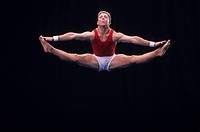 Male gymnast performing on the floor exercise                                                                                                         ...