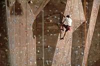 Man climbimg indoor wall