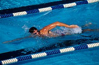 Male swimmer in action                                                                                                                                ...
