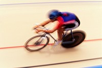 Cyclist racing on the velodrome track                                                                                                                 ...