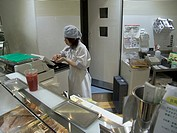 young girl working in a fast food store Tokyo Japan