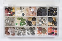 various buttons in a plastic storage box