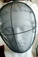 white classic looking plaster head with an old style fencing foil protective mask