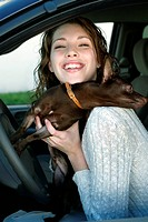 Portrait of a woman in car with dog