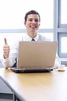 man with thumb up in front of notebook