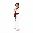 standing boy in tawkwondo uniform