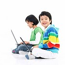 children using laptop computer with sitting on the floor