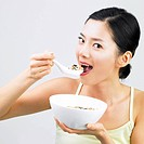 a woman eating a cereal