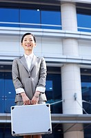 a bussiness woman standing with briefcase