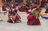 Monks dance with ribbons representing deity powers at the Monlam Chenmo, Katok Monastery _ Kham, Tibet, Sichuan, China