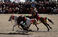 Khampas demonstrate horsemanship by touching the ground, Litang Horse Festival _ Kham, Sichuan Province, China, Tibet