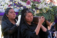 MEXICAN WOMEN carry an statue from TEMPLO DEL ORATORIO DE SAN FELIPE NERI during EASTER PROCESSION _ SAN MIGUEL DE ALLENDE, MEXICO