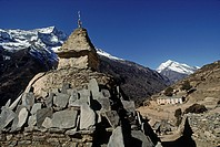 A TIBETAN BUDDHIST CHORTEN with MANI STONES on route to MOUNT EVEREST which is visiblebehind Lhotse _ KHUMBU DISTRICT, NEPAL