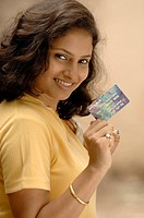 South Asian girl with credit or debit card, Model release number 670