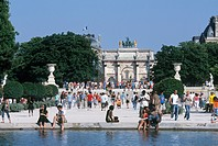 Arc de Triomphe du Carrousel at Jardin des Tuileries garden with the Louvre in back, Paris, France