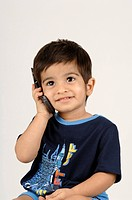 Indian Boy Communicating over the Phone , MR