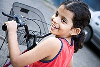 South Asian Indian seven years old girl Sanchi riding bicycle , Bombay Mumbai , Maharashtra , India MR202
