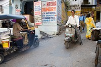 Indian street scene auto rickshaw and two wheeler , Udaipur , Rajasthan , India