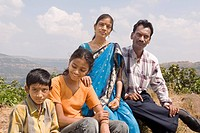 South Asian Indian Maharashtrian couple with kids posing for photograph in the way in Bhimashankar, one of the twelve Jyotirlingas, pune, Maharashtra,...