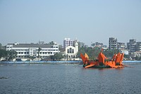 Man made Orange colored Lotus surrounding the Mahadev Mandir in Masunda Lake and Saint John The Baptist Church during Thane Festival ,Thane , Maharash...