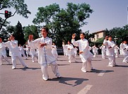 people practising tai chi in white costume
