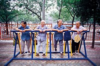 Chinese eldly women doing exercising chatting